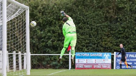 Lee Axworthy of London Colney sees a Sam Ruff of Harpenden Town cross hit the post in the match betw