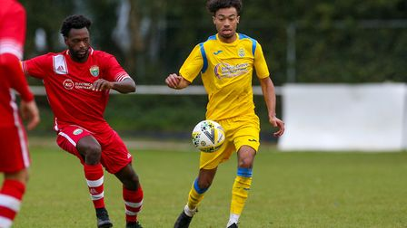 Mulik Rickman of Harpenden Town on the ball in the match between Harpenden Town and London Colney. P