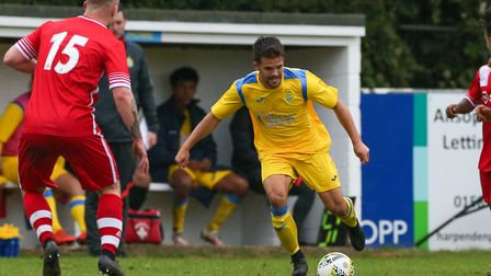 Nathan McGreevy of Harpenden Town cuts inside in the match between Harpenden Town and London Colney.