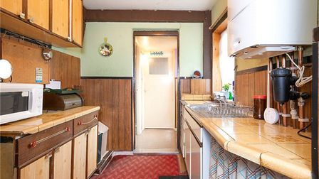 The bathroom and rear garden are accessed via the kitchen. Picture: Collinson Hall