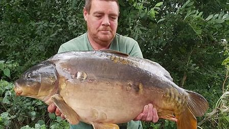 Phil Lee with his catch at St Ives Lakes.