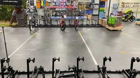 Business has been booming at bike shops such as Halfords (pictured). Picture: Richard Burton