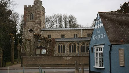 All Saints, Caddington, with The Chequers pub in the foreground. Picture: Danny Loo