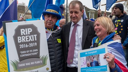 Anti-Brexit campaigners Steve Bray (L) and Alastair Campbell (C) pose outside the Houses of Parliame