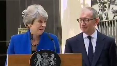 Theresa May and husband Philip reacting to an anti-Brexit protester shouting 'Stop Brexit!' during h