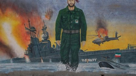 A mural depicts the past conflicts between Iran's revolutionary guards and U.S. navy in the Strait o