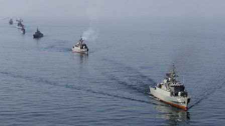 """Iranian Navy boats take part in maneuvers during the """"Velayat-90"""" navy exercises in the Strait of Ho"""