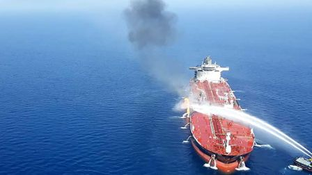 An Iranian navy boat trying to control fire from Norwegian owned Front Altair tanker said to have be