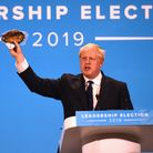 Conservative Party leadership candidate Boris Johnson brandishes a kipper during the final Tory lead