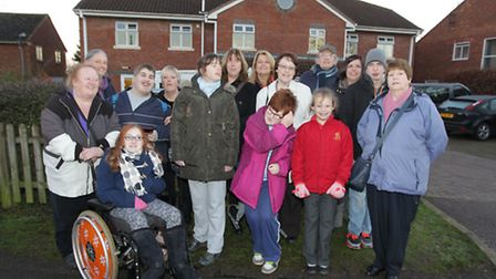 Parents and children outside Wilbury House respite care home which is due to be closed following com