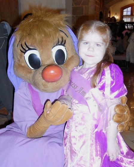 Amelia Mahoney in her princess dress with Cinderella Mouse