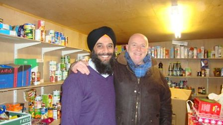 Gurdeep (left) with Gordon have managed to collect many food parcels to help the vulnerable