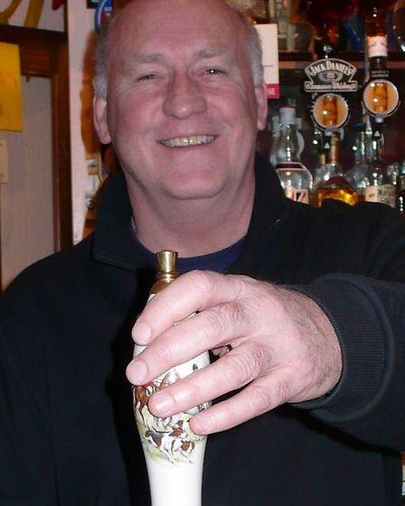 John Pearce pulls the first pint of the Bessemer ale at the Half Moon, Hitchin