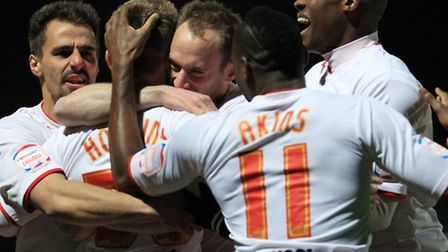 Sam Hoskins is mobbed by team mates celebrating his early goal. Photo: Danny Loo.