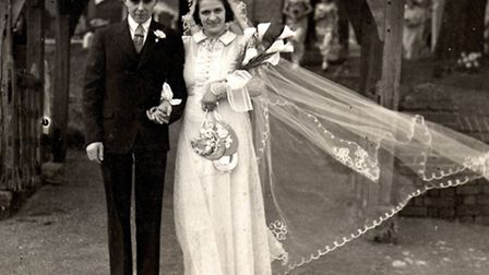 Ray and Helmia Pitts on their wedding day at St Katharine's Church, Ickleford, 70 years ago
