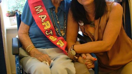 Marjorie Robertson, pictured with Kym Pinder from Roebuck Nursing Home, is celebrating her 100th bir