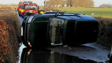 The Landrover ended up on its side. Credit: East of England Ambulance Service