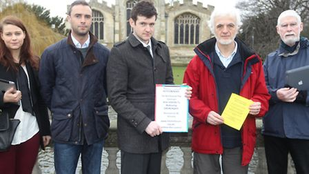 Laura Evans, Alex Brooks, Adrian Smith, Dr. Mike Clarke and Andrew Wearmouth, stand outside St Mary