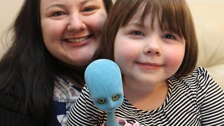 Lily Beecham with her mum, Kelly Richardson at home with Lily's blue alien which she received from A