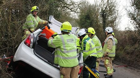 Firefighters work to cut the woman free. Pic: Gary Sanderson
