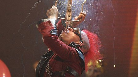 A Circus of Horrors performer attempts a firework sword swallow
