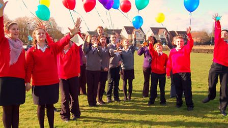 Students from The Priory School in Hitchin release balloons in memory of lost ones
