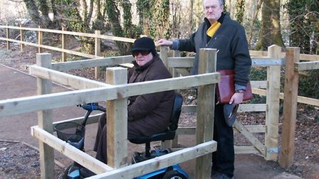 Cllr Robin Parker at the kissing gate in Fry Road with a resident affected