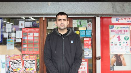 Sinjeet Randhawa outside his store which was robbed last week