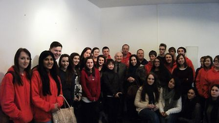 Students from Fearnhill School in Letchworth GC pictured with a survivor during a trip to Auschwitz