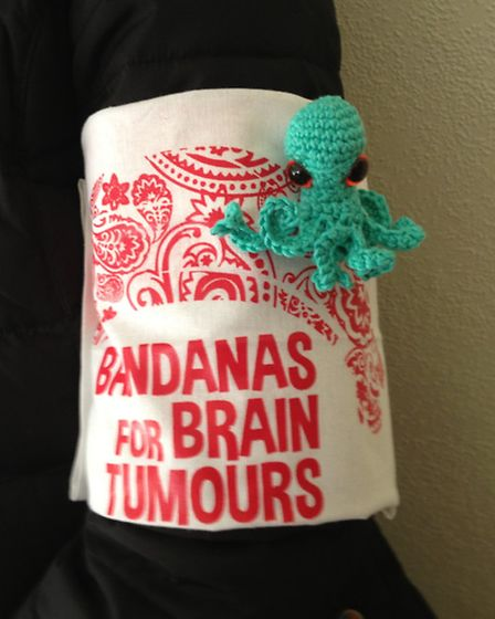 A bandana with an octopus which Jo's daughter has crocheted to raise money for the charity