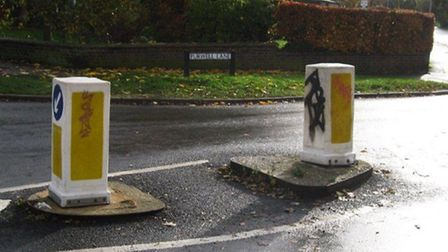 Examples of graffiti on road furniture in Purwell Lane