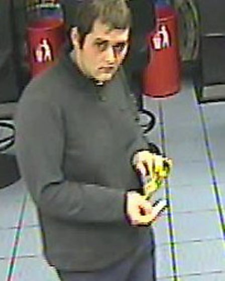 The man is suspected of stealing £140 in coins after distracting a member of staff in William Hill i