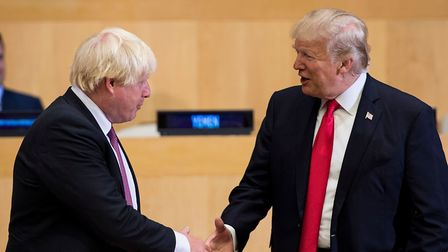 British Foreign Secretary Boris Johnson (L) and US President Donald Trump greet before a meeting on