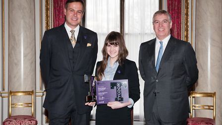 Eleanor Bullough receives her award from Dragons Den star Peter Jones and Prince Andrew, the Duke of
