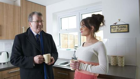 Home Group board member Nick Salisbury chats with Jess Clarke in her kitchen