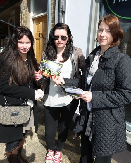 Amanda Vale, Rachel Vale and Julie Lucas with the scratch and sniff card