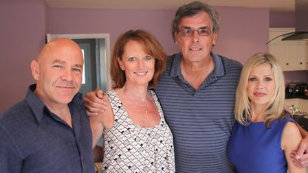 John Smith with his wife Sandra (centre) and Cowboy Builders presenters Dominic Littlewood and Melin