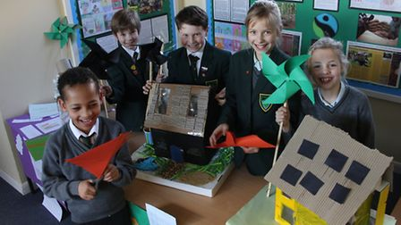 Friends' pupils with their model sustainable homes.