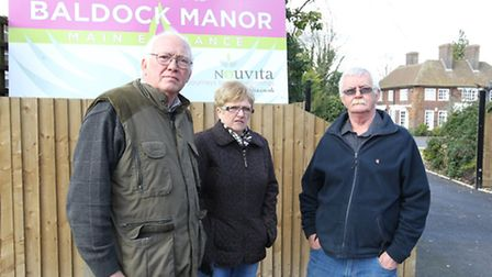 Baldock manor has erected a fence around the unit. Pictured is Cllr Michael Muir, with residents, Sa
