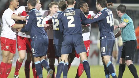 Darius Charles, left, is about to receive a second yellow card. Photo: Harry Hubbard