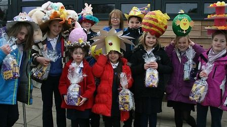 The junior class Easter bonnet winners with Tesco community champion Susie Diggons