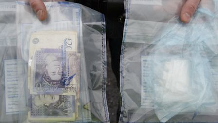 Cash and white powder seized from one of the Hitchin properties