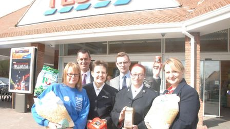 Back, store manager Paul Westwood and Scott Cordall (personnel) and, front from left, Susie Diggons