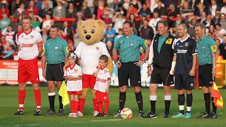 Mark Roberts and Joe Cole line up with Mitchell Cole's children and the match officials