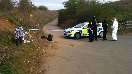 Police and forensic experts at the scene