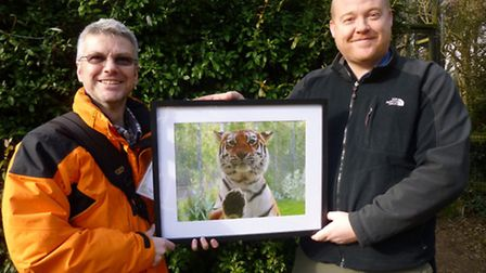 Competition winner Martyn Garvey (left) with his photo and wildlife photographer Colin Edwards.