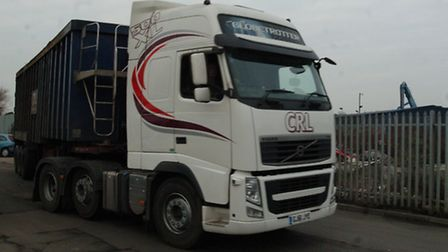 One of the lorries leaves the yard