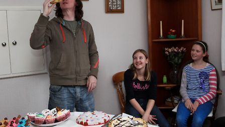 Ed Byrne inspects one of the girls' cakes while Angelica and the winner Hannah (far right) look on.