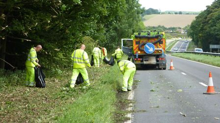 Teams clear the side of the A505 between Hitchin and Luton