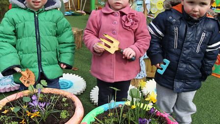 Lewis Lock, 2 , Lyla Wood, 2, and James Boar, 2, with their flowers at Puddleducks Day Nursery in Ba